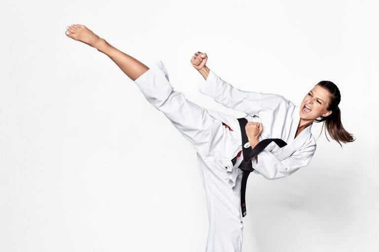 Woman doing a karate kick